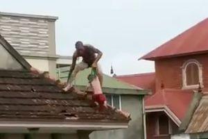 Bất ngờ lý do gã xăm trổ cắp con nhảy như vượn trên mái nhà ở Vinh