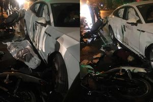 2 xe máy đâm vào xe Audi, cô gái trẻ tử vong, 3 người nguy kịch