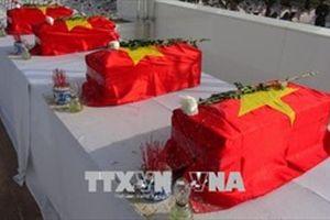 Đưa 30 hài cốt liệt sĩ Việt Nam hy sinh tại Lào về nước