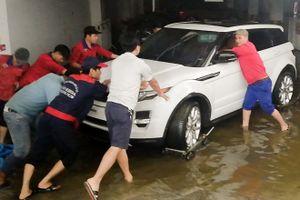 Tranh cãi chuyện đền bù ôtô bị ngâm nước ở chung cư Hoàng Anh Gia Lai