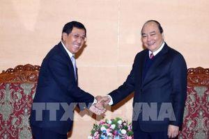 Thủ tướng Nguyễn Xuân Phúc tiếp Thống đốc Ngân hàng Lào