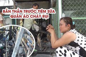 Người phụ nữ bần thần trước tiệm sửa quần áo cháy rụi