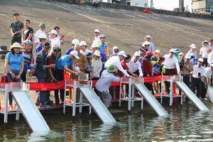Quảng Nam: Thả hơn 50 ngàn con cá giống xuống lòng hồ thủy điện Sông Tranh 2