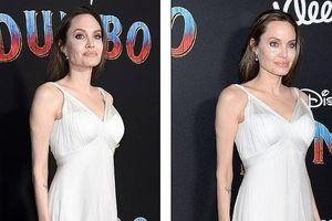 Angelina Jolie diện đầm khoét sâu, lộ loạt hình xăm lớn trên cơ thể