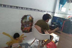 Dân mạng phẫn nộ với bố trẻ 'dán con vào tường' để rảnh tay chơi game