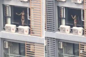 Clip chân dài cởi đồ đứng uốn éo trước cửa sổ chung cư gây ngỡ ngàng