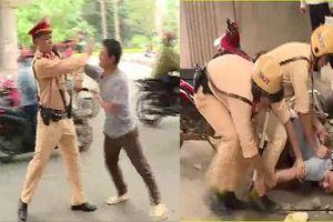 Say rượu, đánh CSGT cứu bạn nhậu vi phạm giao thông ở Hà Nội