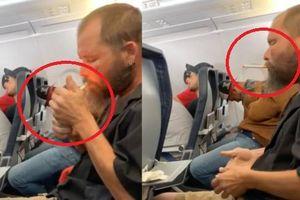 Clip: Gã đàn ông coi thường mạng người, châm lửa hút thuốc trên máy bay