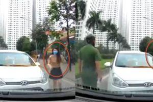 Clip lái ô tô ngược chiều còn thi gan, nữ tài xế đeo khẩu trang tái mặt khi thấy công an