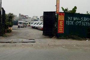 Bãi đỗ xe không phép trên đất NN ở Tân Khai: Sao chưa xử lý?