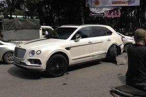 Hà Nội: Va chạm giao thông với xe taxi, xe sang Bentley Bentayga hư hỏng một bánh sau