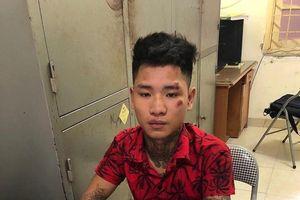Khởi tố thanh niên xăm trổ tông gục cảnh sát giao thông