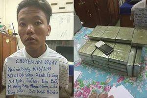 Nam thanh niên sa lưới khi mang 30 bánh heroin từ Lào về Việt Nam
