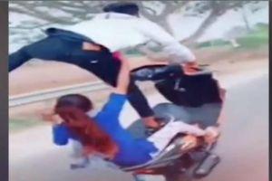 Thanh niên lái xe bằng một chân, chở bạn gái bốc đầu trên cao tốc