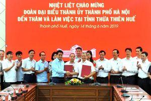 Thúc đẩy mạnh mẽ sự phát triển của Hà Nội và Thừa Thiên - Huế