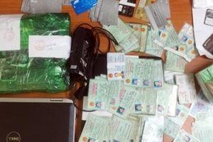 Làm giả 100 CMND và hộ khẩu để vay tiền trên ứng dụng online