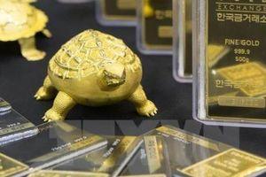 Giá vàng thế giới quay đầu giảm sau số liệu giá tiêu dùng của Mỹ