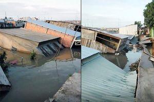 Sạt lở lúc sáng sớm, nhiều căn nhà trôi xuống sông