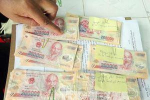Đánh sập đường dây tàng trữ, mua bán tiền giả ở Đắk Nông