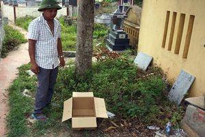 Bàng hoàng phát hiện thi thể bé sơ sinh trong thùng giấy ở nghĩa trang