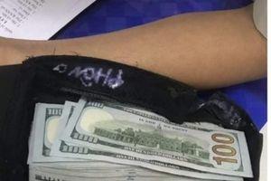 Khách Trung Quốc quên túi xách chứa cả chục nghìn USD ở sân bay