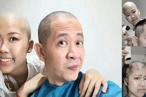 Đạo diễn 'Những ngọn nến trong đêm' cạo trọc đầu, hiến tủy cứu con gái ung thư