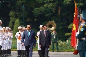 Lễ đón Thủ tướng CHDCND Lào Thongloun Sisoulith thăm chính thức Việt Nam