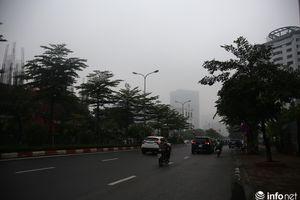 Hà Nội ngập trong sương mù bao phủ tầm nhìn