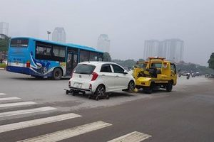 Nghi vấn có liên minh 'chặt chém' giá cẩu xe vi phạm giao thông ở Hà Nội?