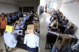 Giáo viên bắt học sinh đội thùng carton lên đầu để chống gian lận khiến nhiều người tức giận