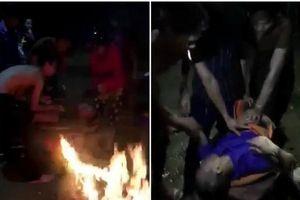 Đốt rơm rạ để sưởi ấm, cứu sống người bị đuối nước trên sông Lam