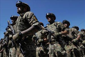 Chính phủ Ukraine và lực lượng ly khai bắt đầu rút quân khỏi khu vực miền Đông
