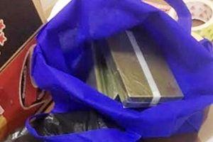 Cô giáo vận chuyển 5 bánh heroin, hối lộ 1 tỉ đồng nhưng không thoát