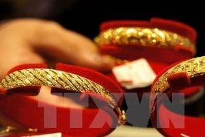 Giá vàng châu Á đi xuống trong phiên cuối tuần