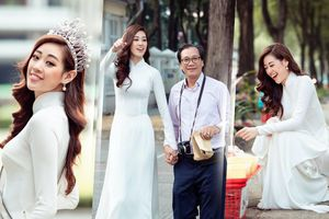 Hoa hậu Khánh Vân diện áo dài trắng đẹp dịu dàng dạo phố cùng bố, tiết lộ về hoa tai may mắn