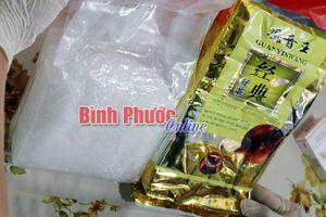 Bắt giữ hai đối tượng mang gần 1 kg ma túy đá từ TPHCM đến Bình Phước