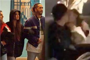 Ariana Grande hôn trai lạ trong quán bar