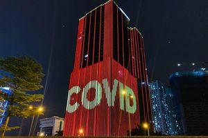 Hà Nội: Các tòa nhà cao tầng thắp sáng thông điệp đẩy lùi dịch bệnh COVID-19