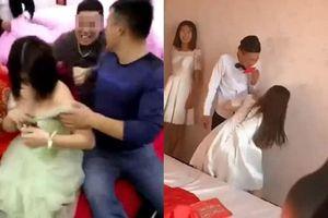 Hình ảnh xấu xí về hủ tục náo hôn ở Trung Quốc: Chú rể hôn phù dâu, phủ rể sàm sỡ phù dâu
