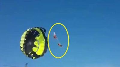 Cặp đôi bay dù lượn vướng vào dây điện cao thế 'giật tung người'