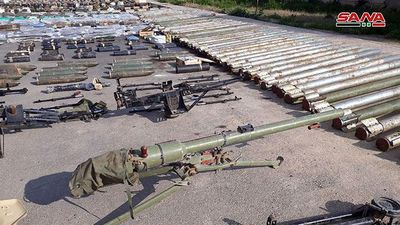 Quân đội Syria thu hoạch vũ khí của 'quân thánh chiến' tại ngoại ô Damascus