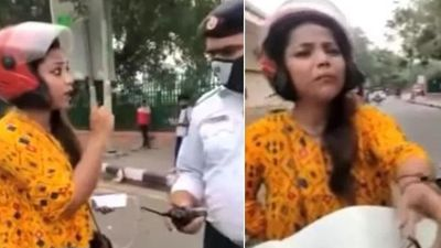 Bị cảnh sát chặn xe, nữ tài xế quăng mũ bảo hiểm rồi dọa tự tử