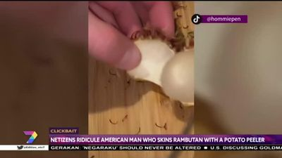 Ông Tây loay hoay phải dùng dao và nạo để ăn... quả chôm chôm