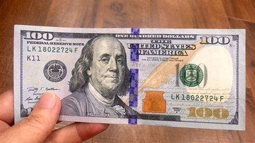 Phạt chủ tiệm vàng 40 triệu vì mua 100USD: 'Tại sao mua?'
