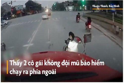 Hai cô gái chạy tạt đầu xe container vì bị bóp còi